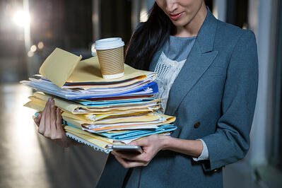 Business woman carrying paper visitor log files