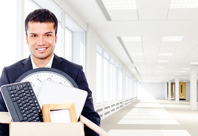Employee with a packed box moving offices