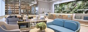 Comfortable furniture and indoor greenery at Hong Kong's The Work Project