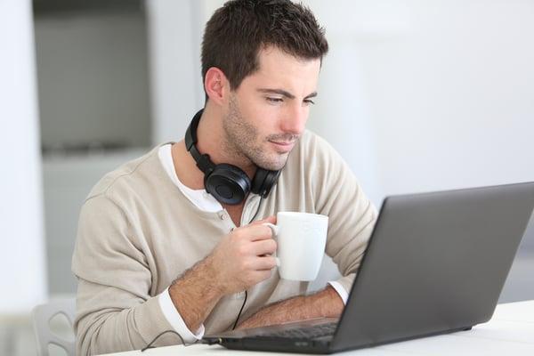 Coworking space member enjoying coffee while working