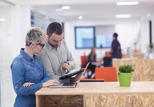 Investors reviewing coworking space management software
