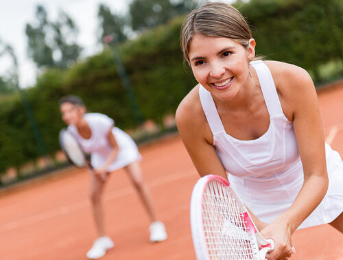 Woman practicing to get better at tennis