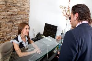 Receptionist greeting visitors