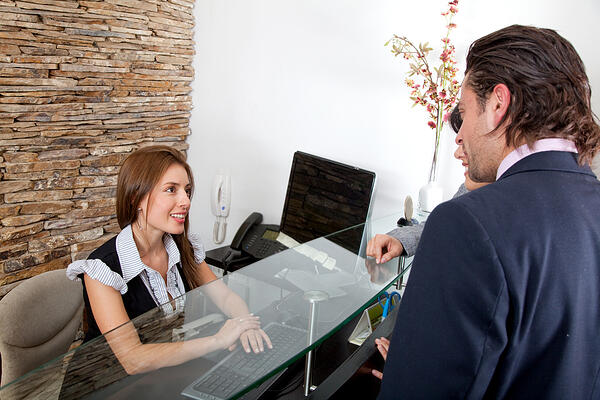 Receptionist greeting visitors