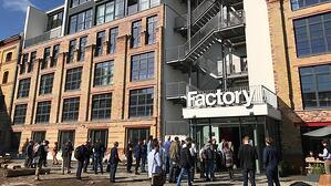 People walking in front of Factory coworking space entrance