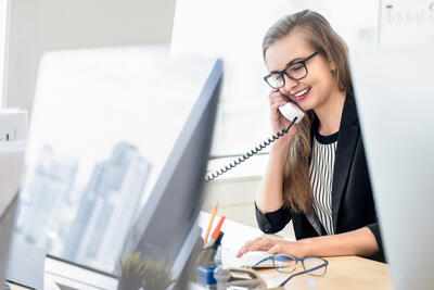 Female employee receiving voice call reception-notification
