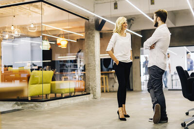 Community manager speaking with a member in her coworking space