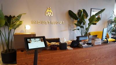 A coworking space using a visitor registration app and kiosk