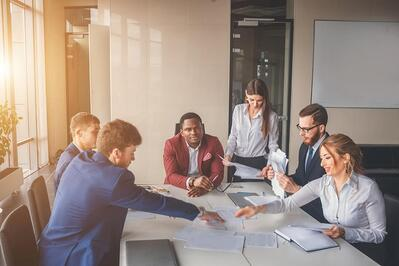 Employees collaborating in a conference room