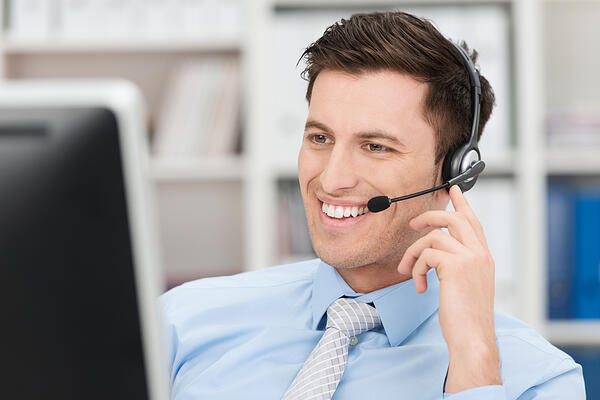 Receptionist smiling while talking on the phone