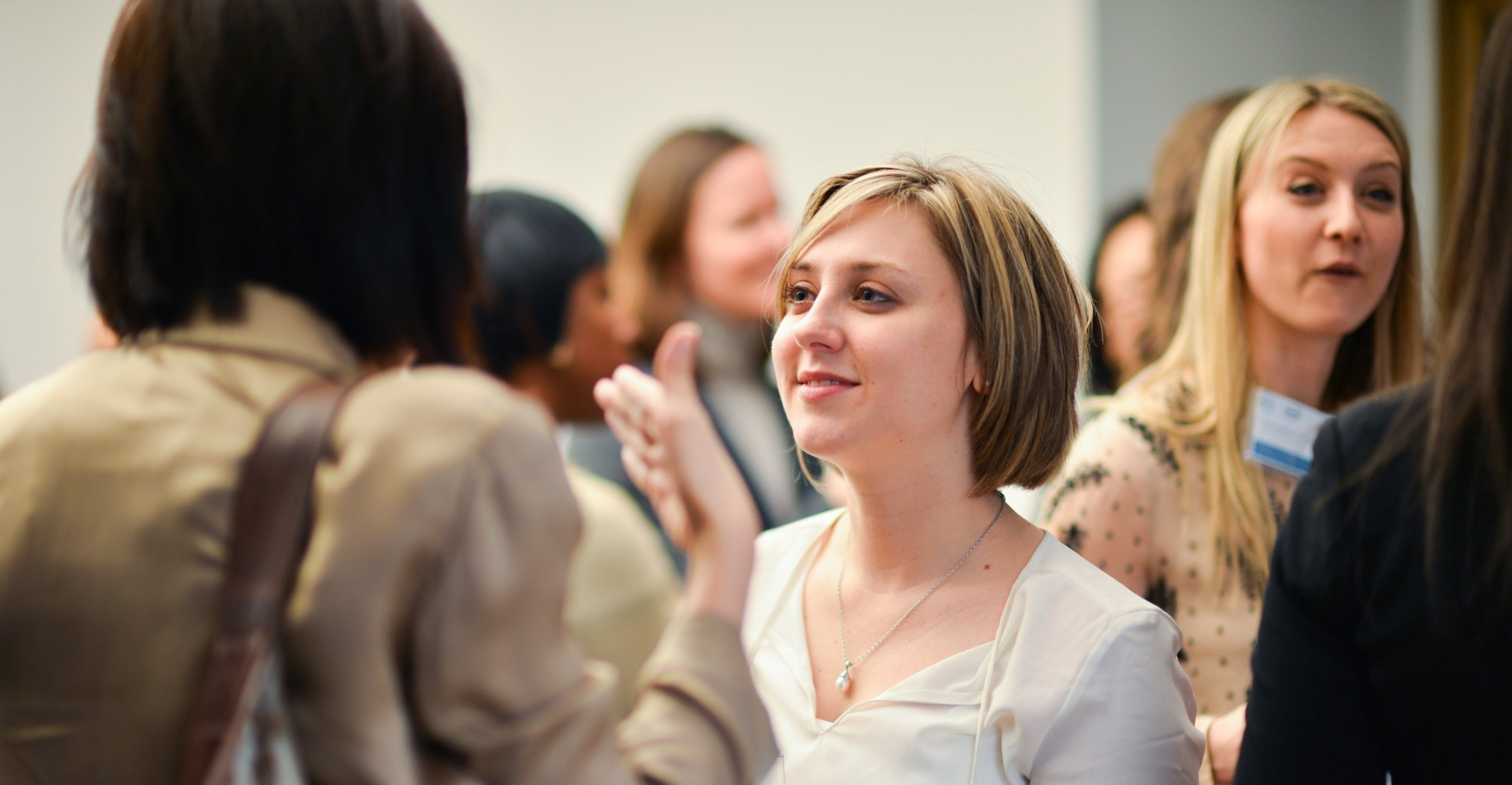 Business woman confident at networking event
