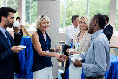 Professionals introducing themselves at a networking event