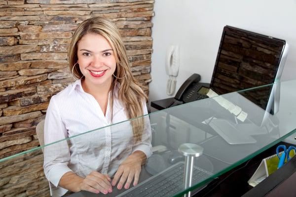 Live receptionist or visitor registration app checks guests in