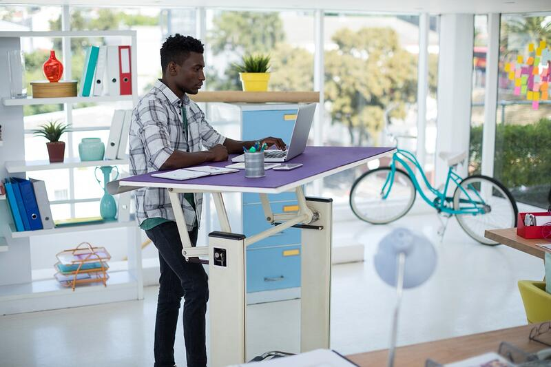 Employee workstation features modern office furniture
