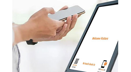 Visitor using a touchless visitor management system