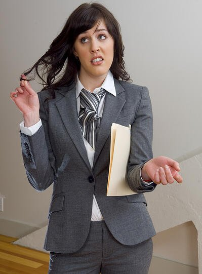 No visitor management system leaves woman annoyed in office lobby