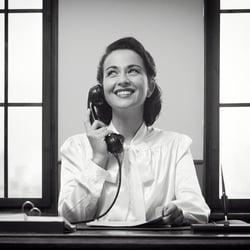 Mad Men era receptionist in black-and-white