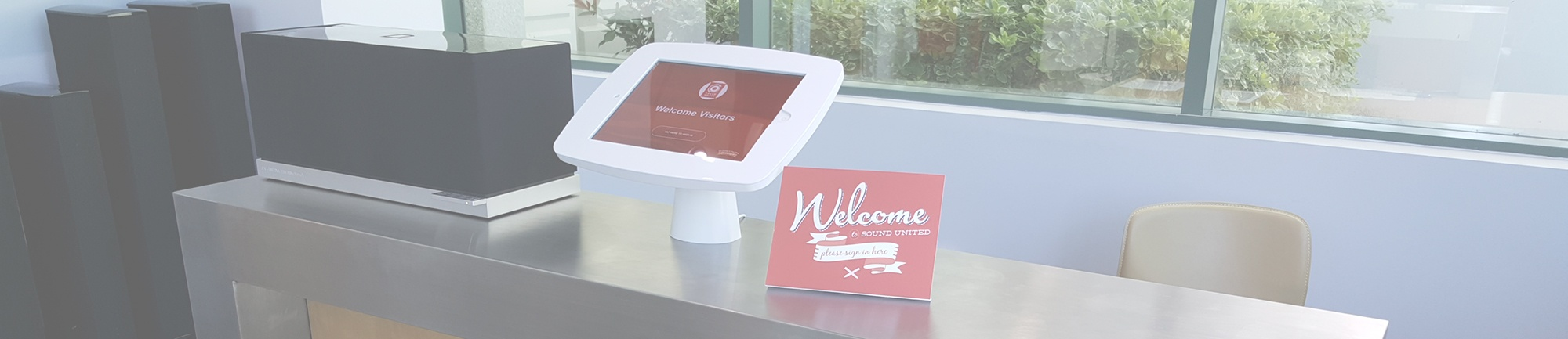 Beautiful reception area features a visitor sign-in app