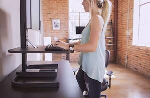 Woman in an urban office using a standing desk
