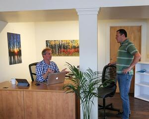Corner Coworking owner Mark Eaton working with a member