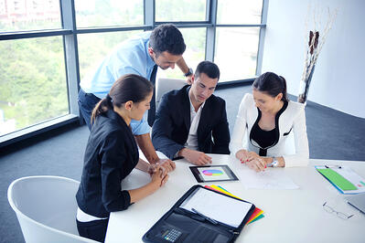 Workers collaborating in a modern office conference room