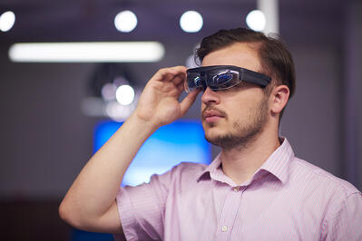Employee using high tech augmented reality glasses