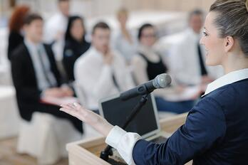 Woman presenting at an industry event