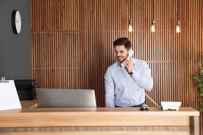 receptionist-managing-digital-visitor-log