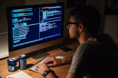 Developer working in the dark with lots of caffeine