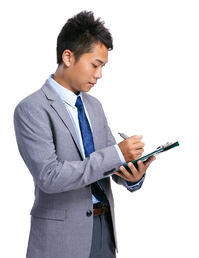 Businessman reviewing visitor log during a workplace emergency