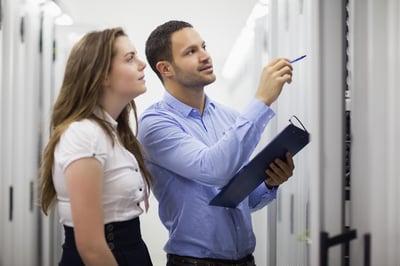 Employees walking through a server room