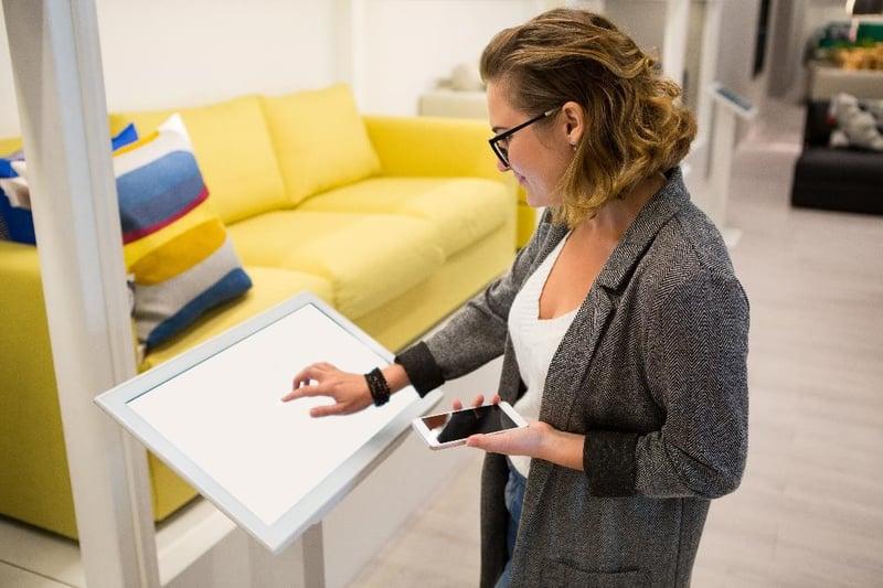 Visitor using self check-in app kiosk