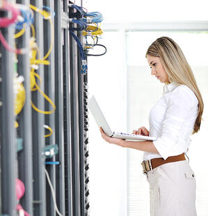 Female engineer maintaining servers and data security