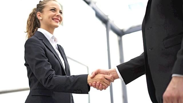 Handshake in office reception area