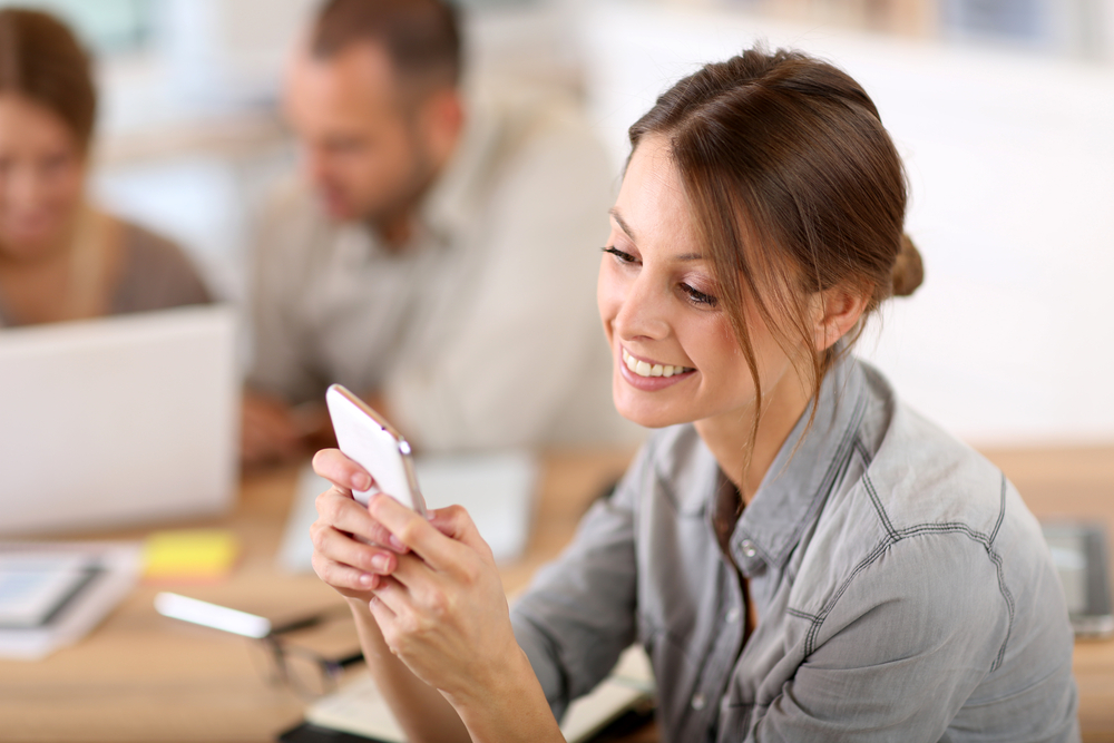 Female employee checking her text messages