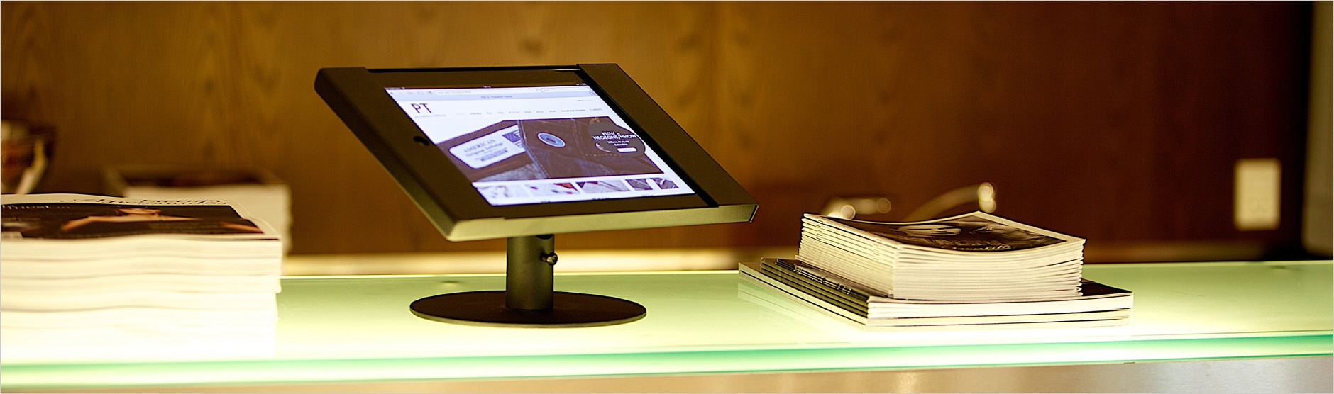 Digital visitor management app on reception desk