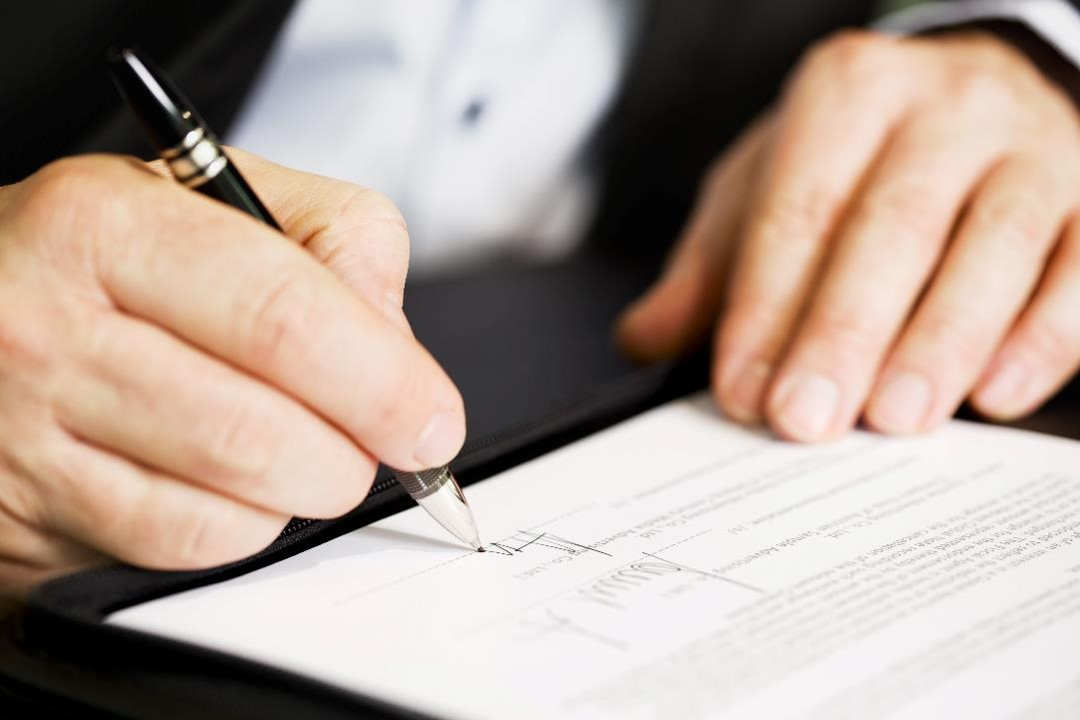 signing a paper legal document