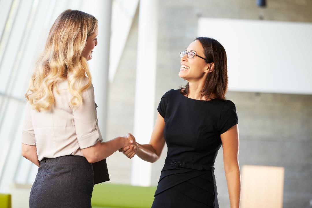 greeting a candidate in a modern office reception ar